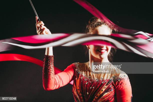Portrait of a Young Rhythmic Gymnastics Athlete with Ribbon