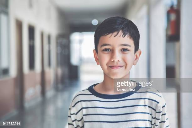portrait of a young school boy smiling - indian ethnicity stock pictures, royalty-free photos & images