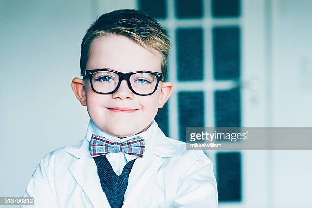 Portrait of a young scientist with glasses and bowtie