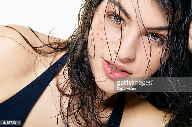 portrait of a young sensual woman with wet and tousled hair - donna seducente foto e immagini stock