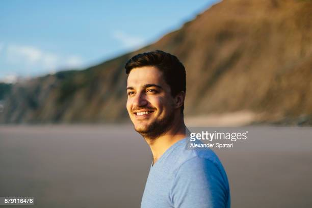 portrait of a young smiling happy man - southern european descent stock pictures, royalty-free photos & images