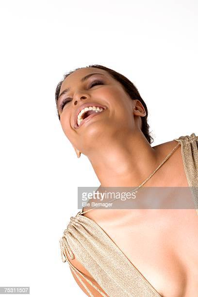 portrait of a young smiling woman in low-cut dress - bend over cleavage stock photos and pictures