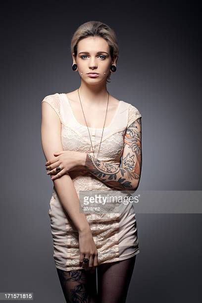 portrait of a young tattooed woman - female body piercing stock photos and pictures