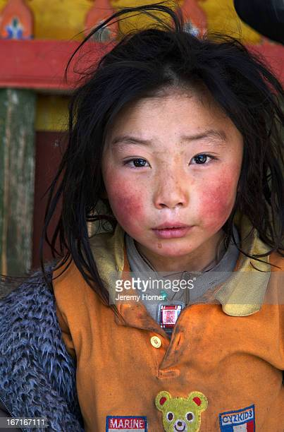 Portrait of a young tibetan boy from Amdo at Labrang Monastery during Tibetan New Year celebrations Labrang Monastery is one of six monasteries of...