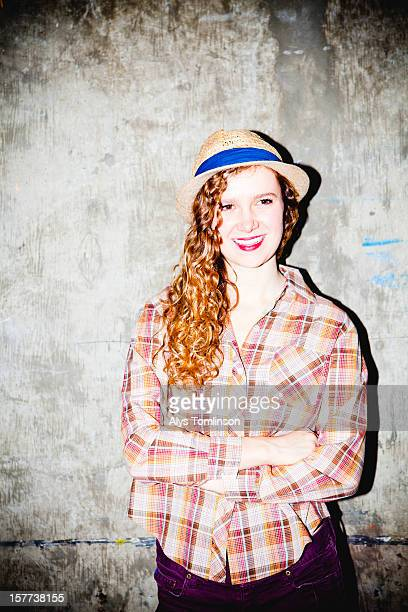 Portrait of a young woman against a wall