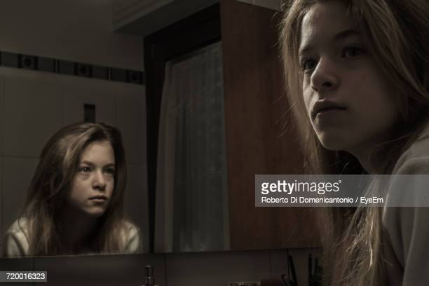 portrait of a young woman and reflection - schizophrenia stock pictures, royalty-free photos & images