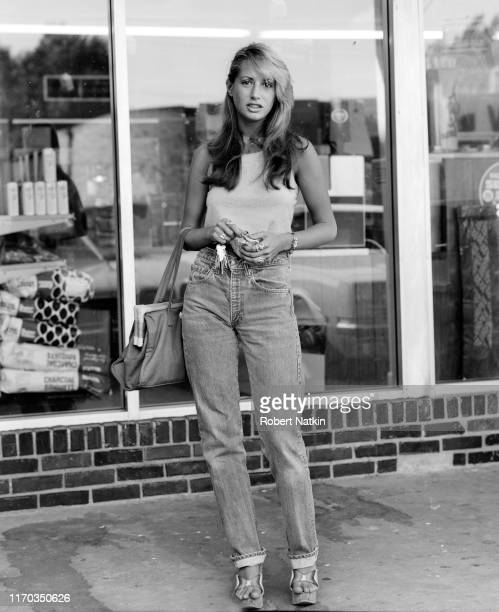 Portrait of a young woman as she poses in front of a shop window on Devon Avenue Chicago Illinois 1970s