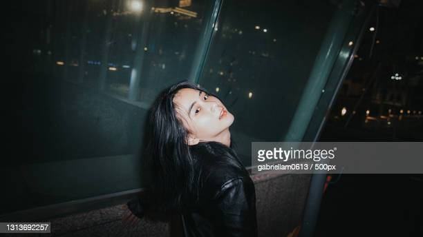 portrait of a young woman at night in the city - editorial stock pictures, royalty-free photos & images