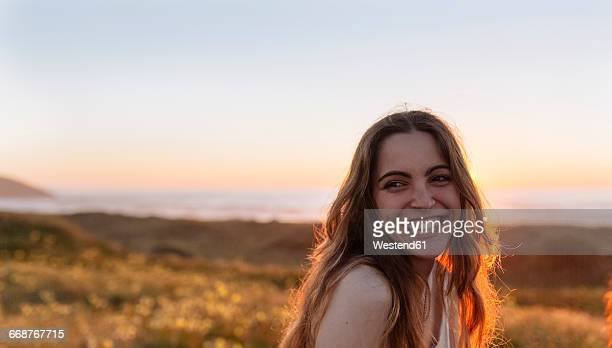 Portrait of a young woman at sunset on the beach