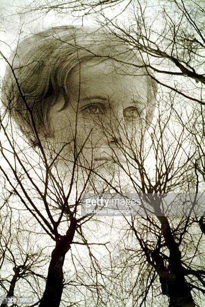 Portrait of a young woman between bleak trees