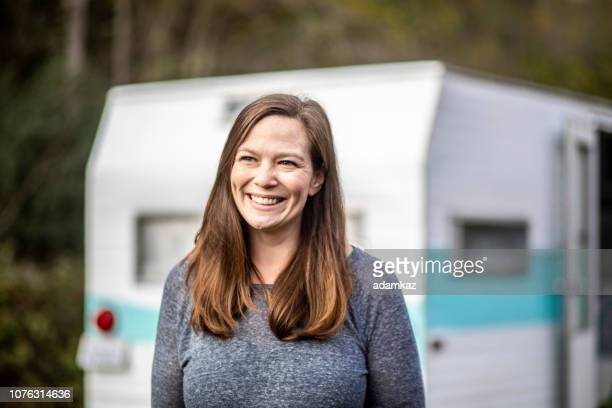 Portrait of a young woman camping at her trailer