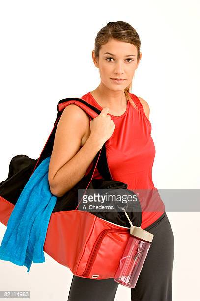Portrait of a young woman carrying a gym bag