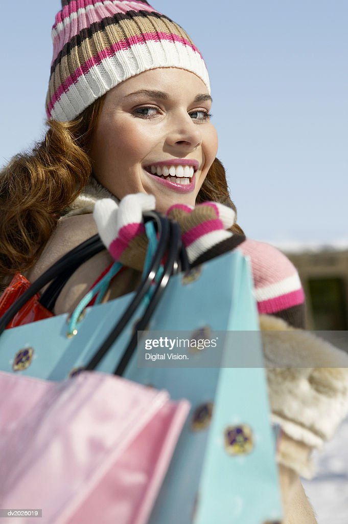 Portrait of a Young Woman Carrying Shopping Bags : Stock Photo