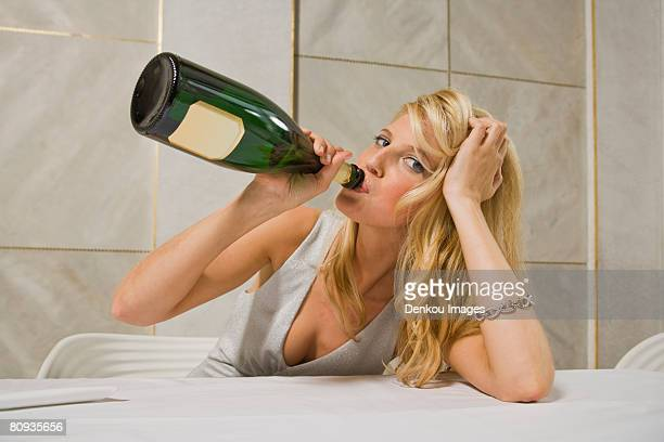 Portrait of a young woman drinking champagne