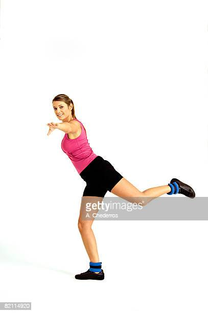 Portrait of a young woman exercising
