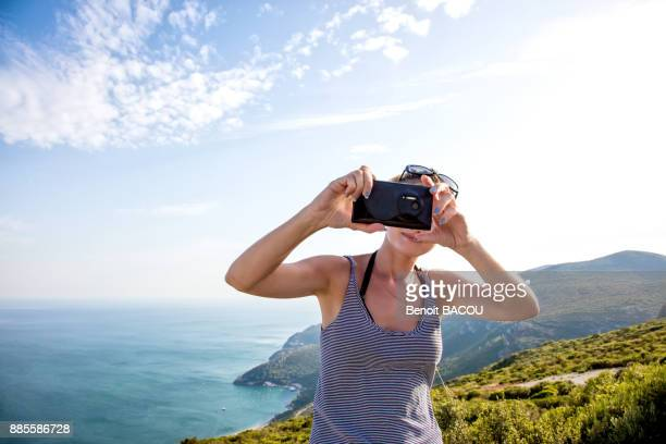 Portrait of a young woman face, taking a selfie with smartphone on the heights of Setubal, Lisbon area, Portugal