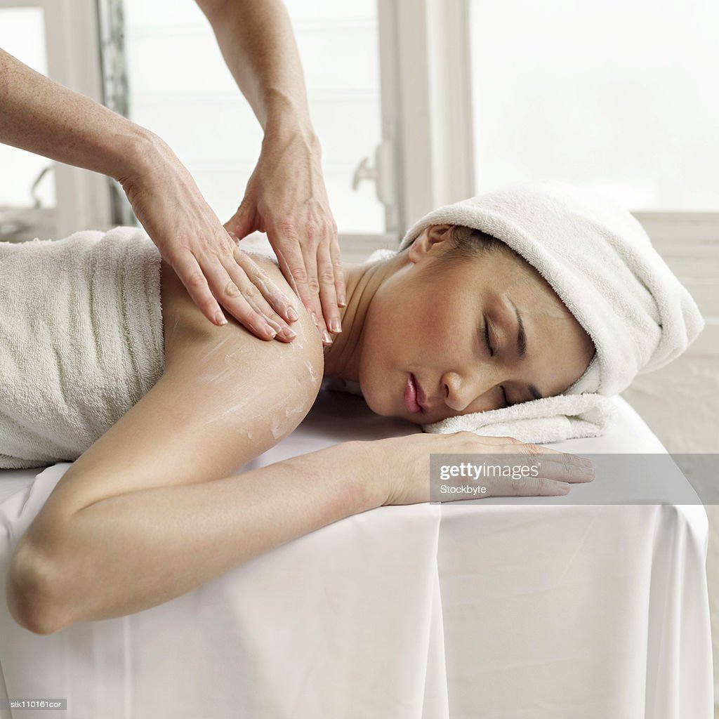 portrait of a young woman getting a massage : Stock Photo