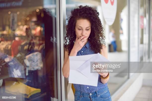 portrait of a young woman getting the mail - bericht stockfoto's en -beelden