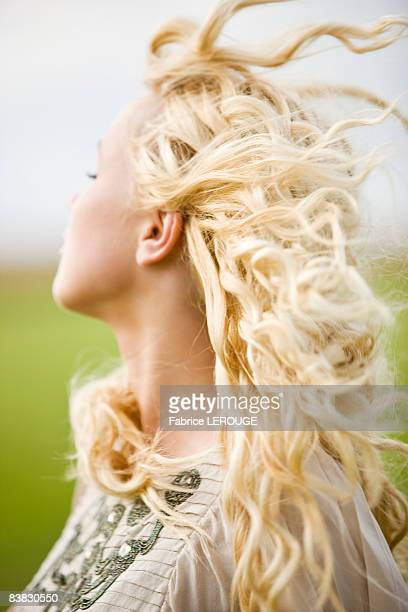 Portrait of a young woman, hair in the wind