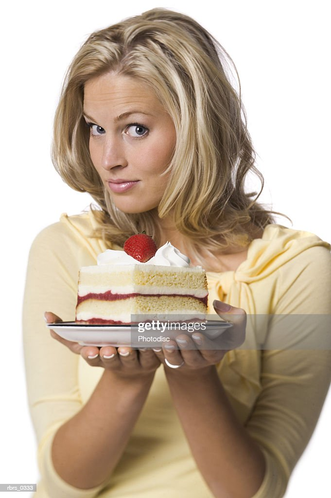 Portrait of a young woman holding a birthday cake : Foto de stock