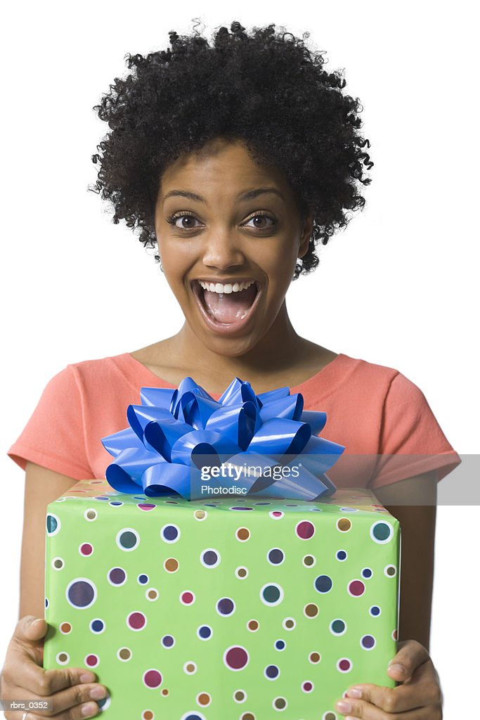 Portrait of a young woman holding a gift : Foto de stock