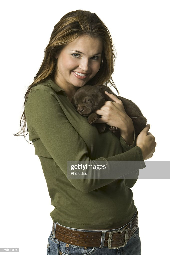 Portrait of a young woman holding a puppy : Foto de stock