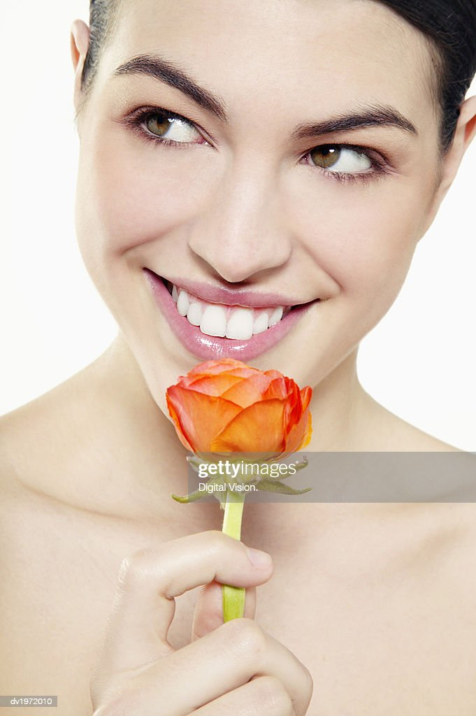 Portrait of a Young Woman Holding a Single Flower : Stock Photo