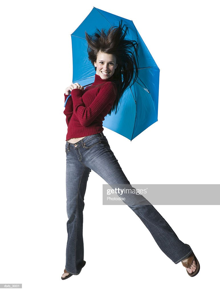 Portrait of a young woman holding an umbrella : Foto de stock