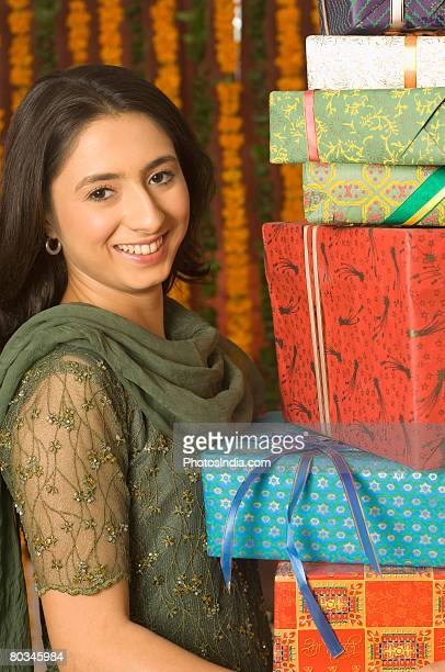 portrait of a young woman holding gifts - salwar kameez stock pictures, royalty-free photos & images