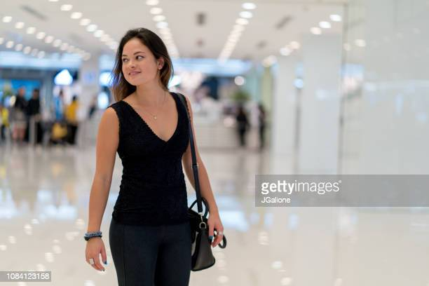 Portrait of a young woman in a shopping mall