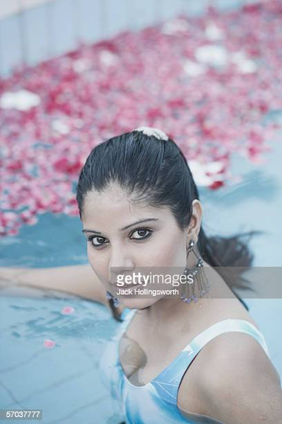 portrait of a young woman in a swimming pool - indian cleavage stock pictures, royalty-free photos & images