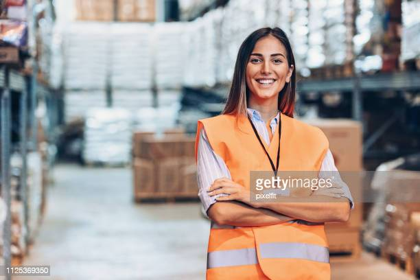 portrait of a young woman in a warehouse - waistcoat stock pictures, royalty-free photos & images