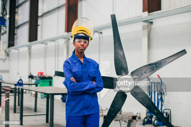 portrait of a young woman in an engineering workshop - one young woman only stock pictures, royalty-free photos & images