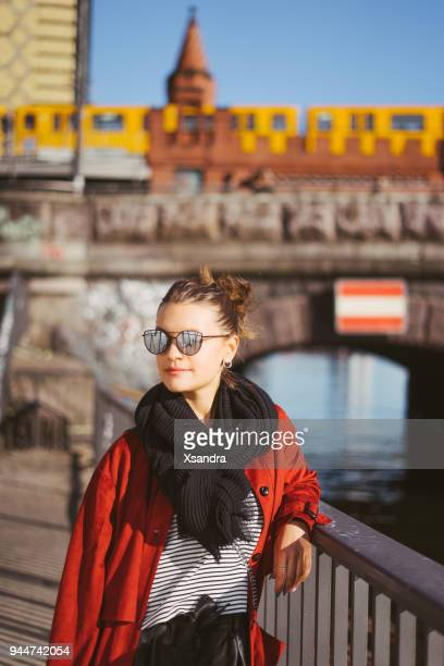 portrait of a young woman in berlin - friedrichshain stock photos and pictures