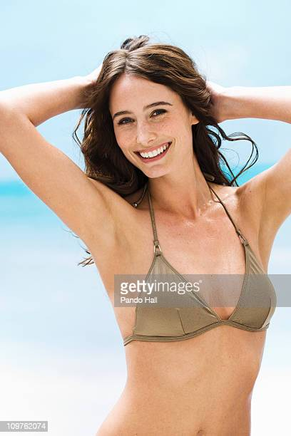 Portrait of a young woman in bikini top smiling
