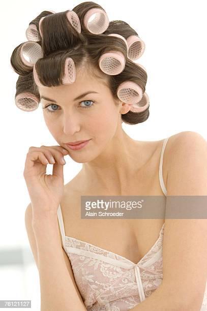 portrait of a young woman in curlers - krulspelden stockfoto's en -beelden