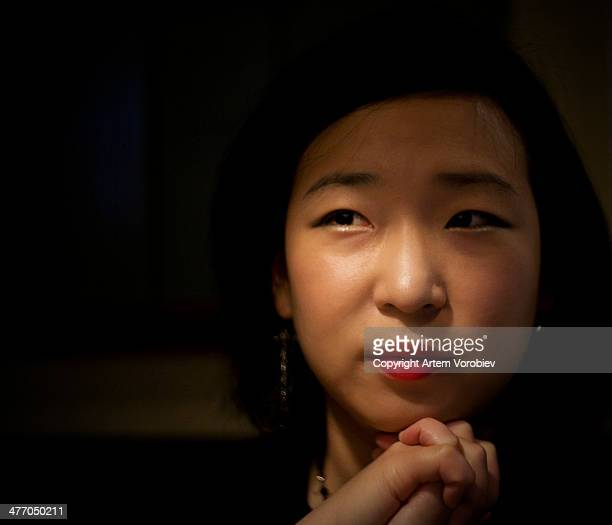 Portrait of a young woman in low light