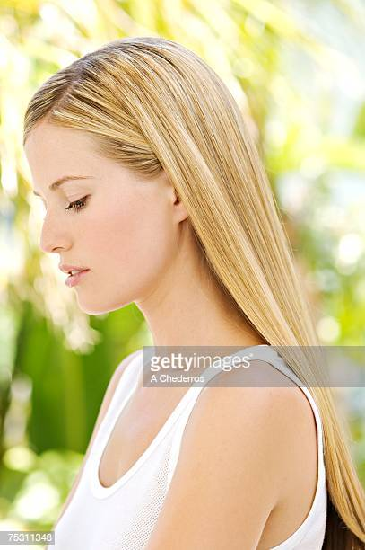 Portrait of a young woman in profile outdoors