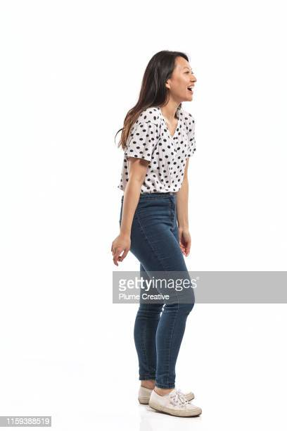 portrait of a young woman in studio - side view stock pictures, royalty-free photos & images