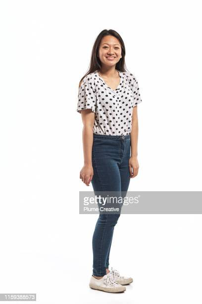 portrait of a young woman in studio - silhouette stock pictures, royalty-free photos & images
