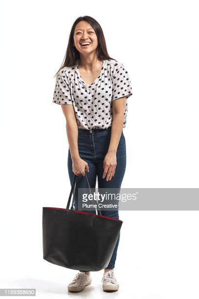 portrait of a young woman in studio - trousers stock pictures, royalty-free photos & images