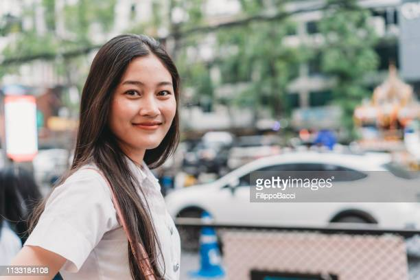 portrait of a young woman in the city. bangkok, thailand - cambodian culture stock photos and pictures