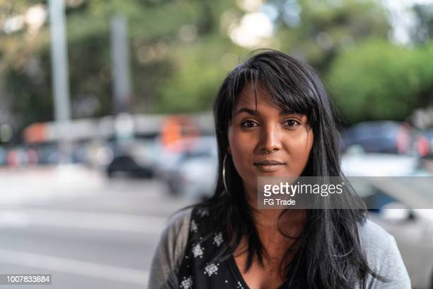 portrait of a young woman in the city - serious stock pictures, royalty-free photos & images