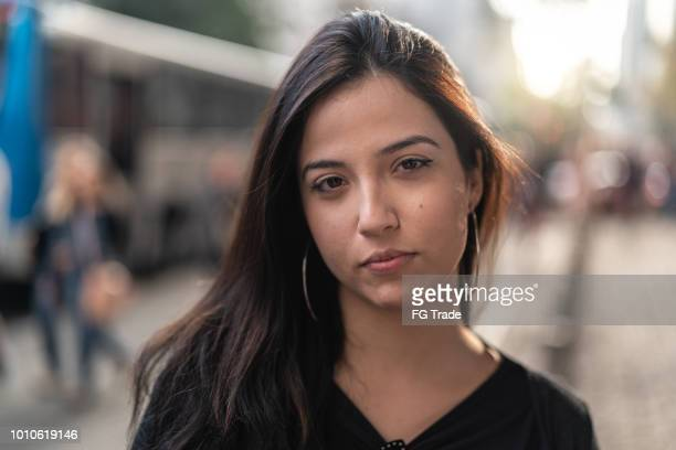 portrait of a young woman in the city - city life stock pictures, royalty-free photos & images