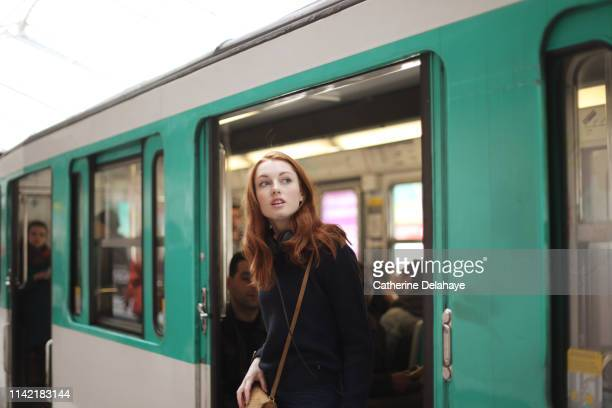 portrait of a young woman in the subway in paris - transporte público imagens e fotografias de stock