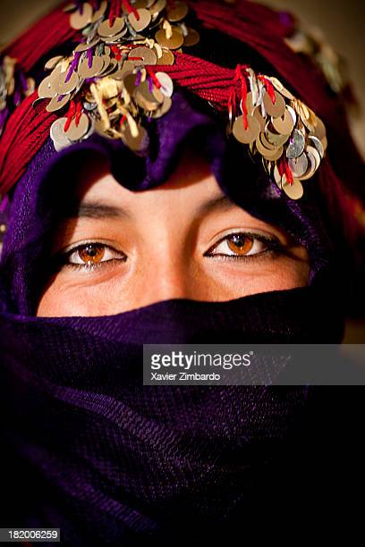Portrait of a young woman in traditional dress on September 22 2010 at Imilchil in Atlas Mountains Morocco