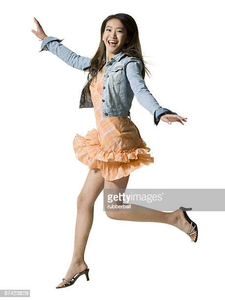 Portrait of a young woman jumping