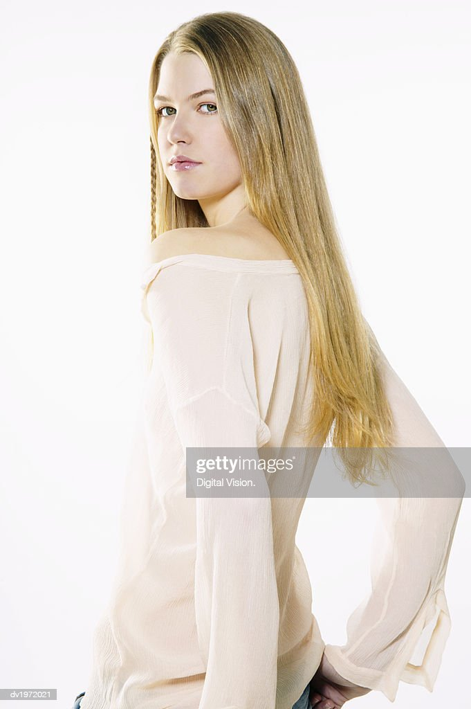 Portrait of a Young Woman Looking Back With Her Hands on Her Hips : Stock Photo