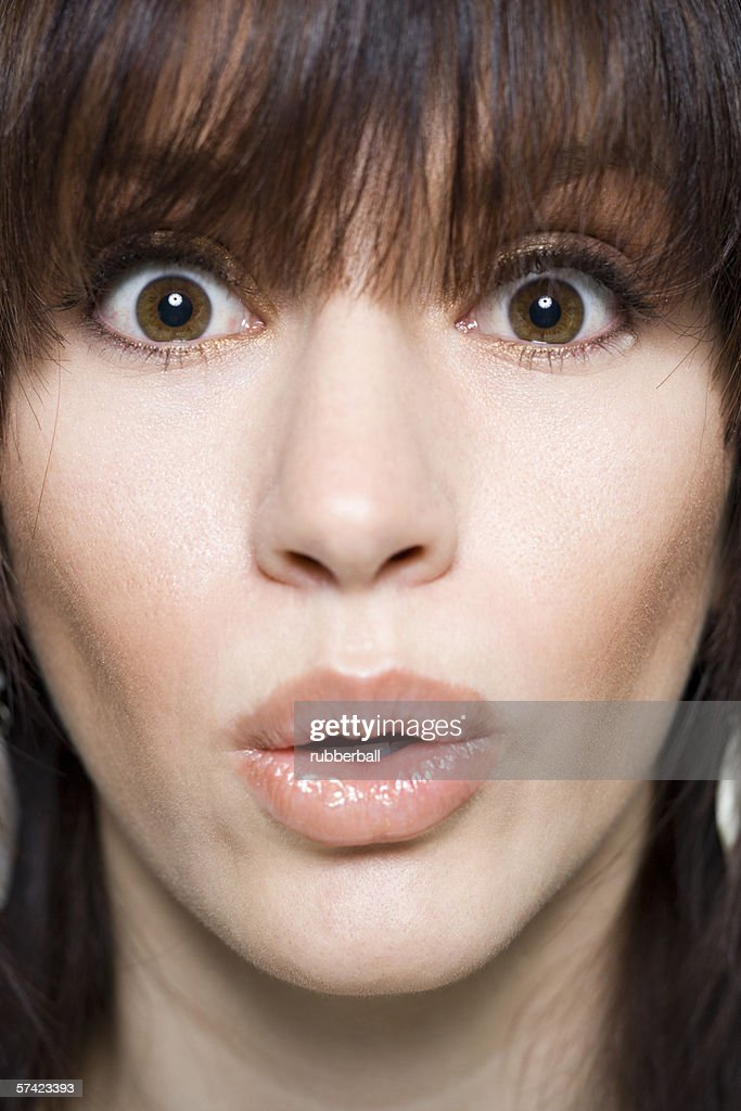 Young woman looking surprised — Stock Photo © gzorgz
