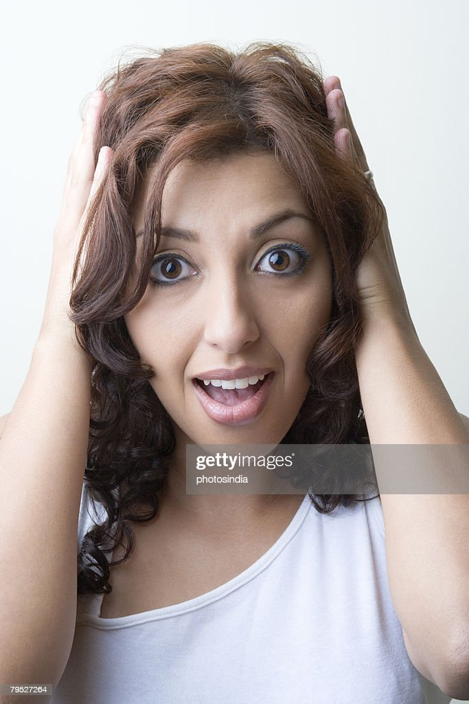 Young Woman Looking Surprised Stock Photo - Image of adult